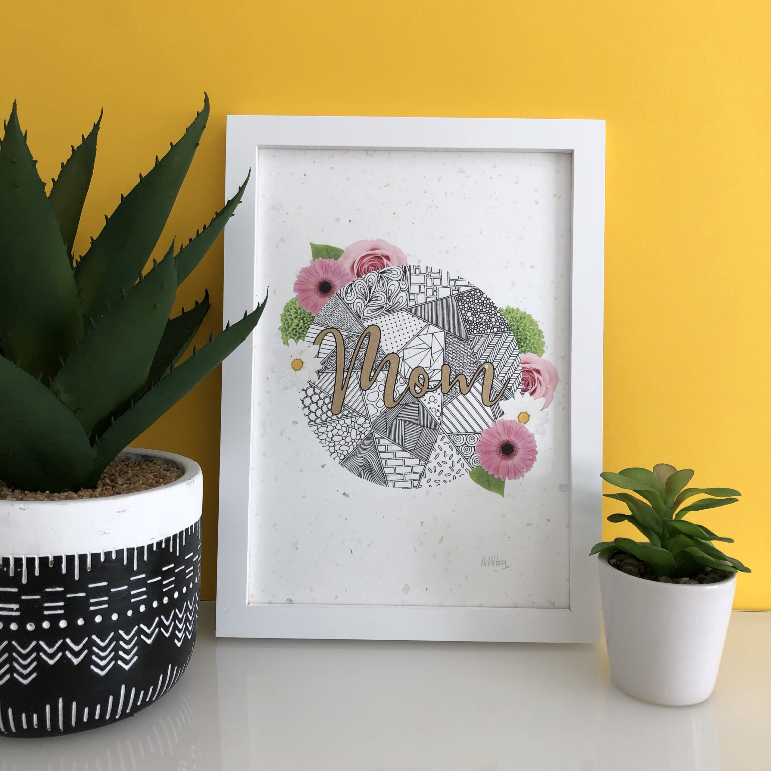 This gorgeous A4 art print features zentangle inspired patterns decorated with pink gerberas, pink roses and daisies, hand-finished with metallic gold detailing to the letters. The design is printed onto exquisite, handmade paper featuring flecks of gold and silver foil throughout.