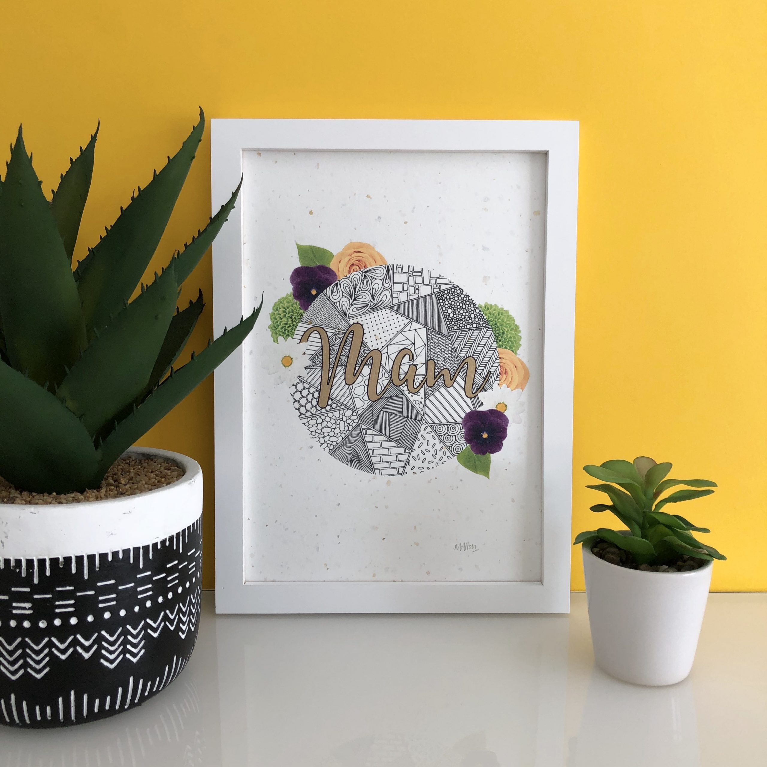 This gorgeous A4 art print features zentangle inspired patterns decorated with purple pansies, yellow roses and daisies, hand-finished with metallic gold detailing to the letters. The design is printed onto exquisite, handmade paper featuring flecks of silver and gold foil throughout.