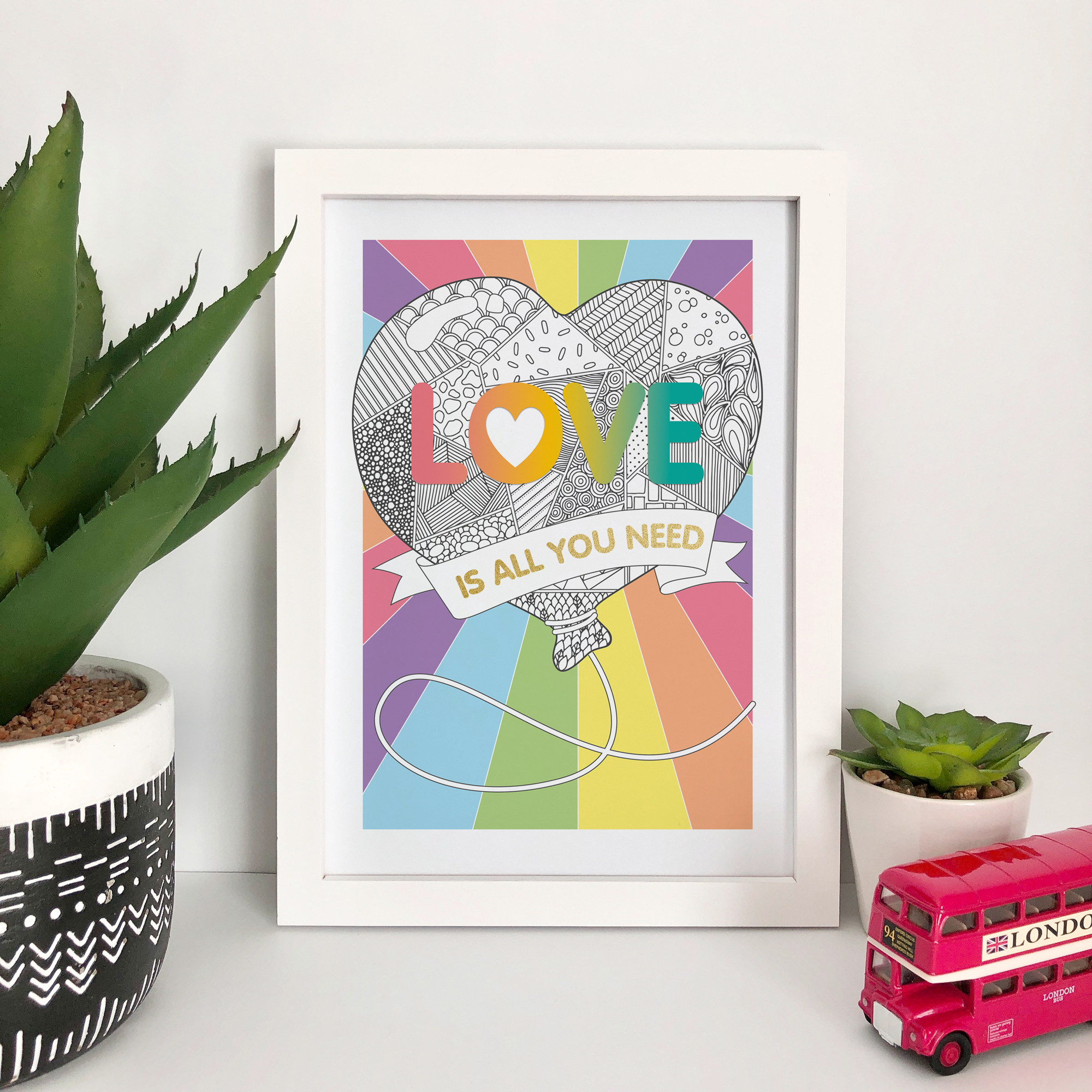 This gorgeous design features the Beatles lyric 'Love is all you need' with a zentangle patterned heart shaped balloon and a choice of rainbow, pink, grey or blue background.