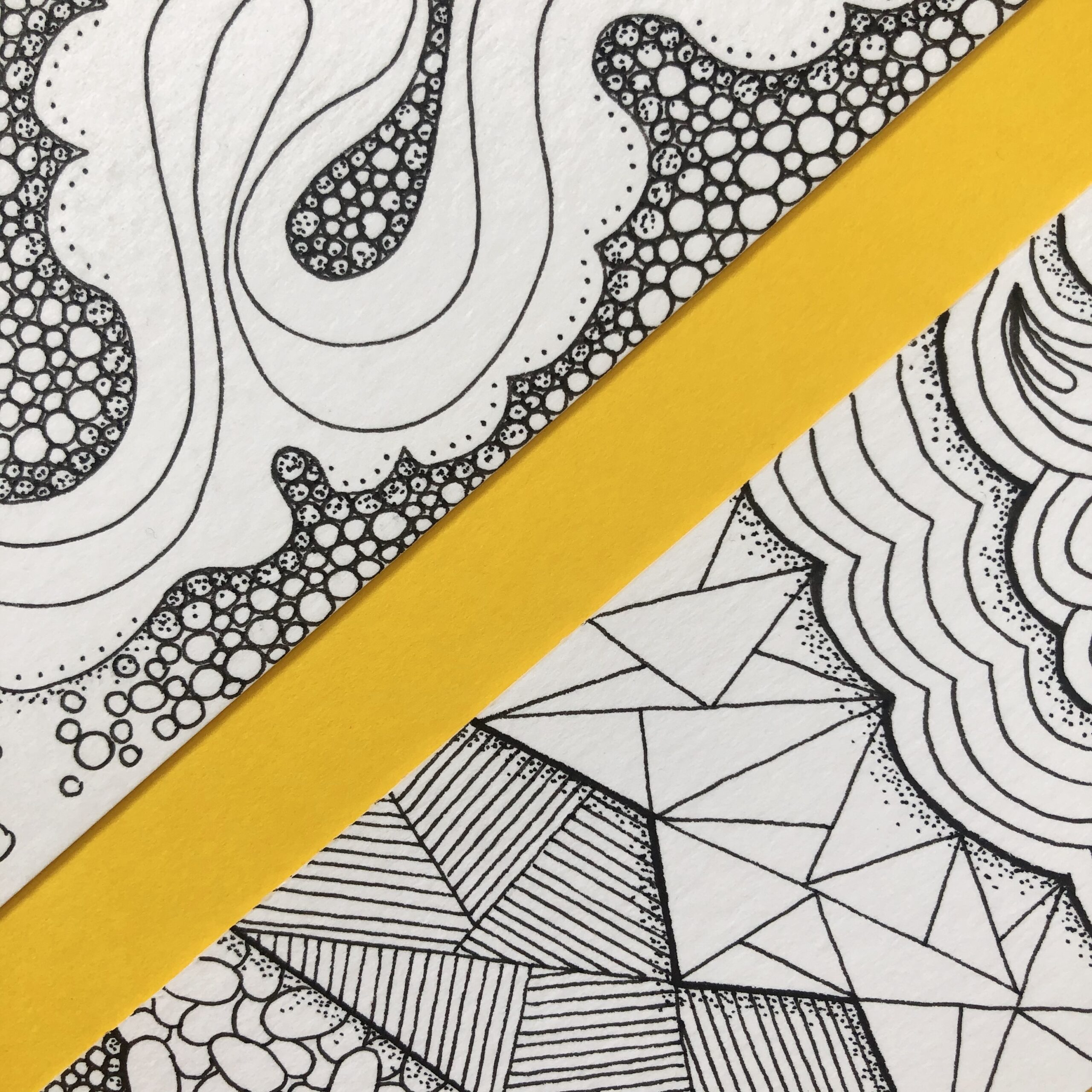 Close-up section of two hand drawn, handcrafted bookmarks featuring zentangle patterns, perfect gift for bookworms