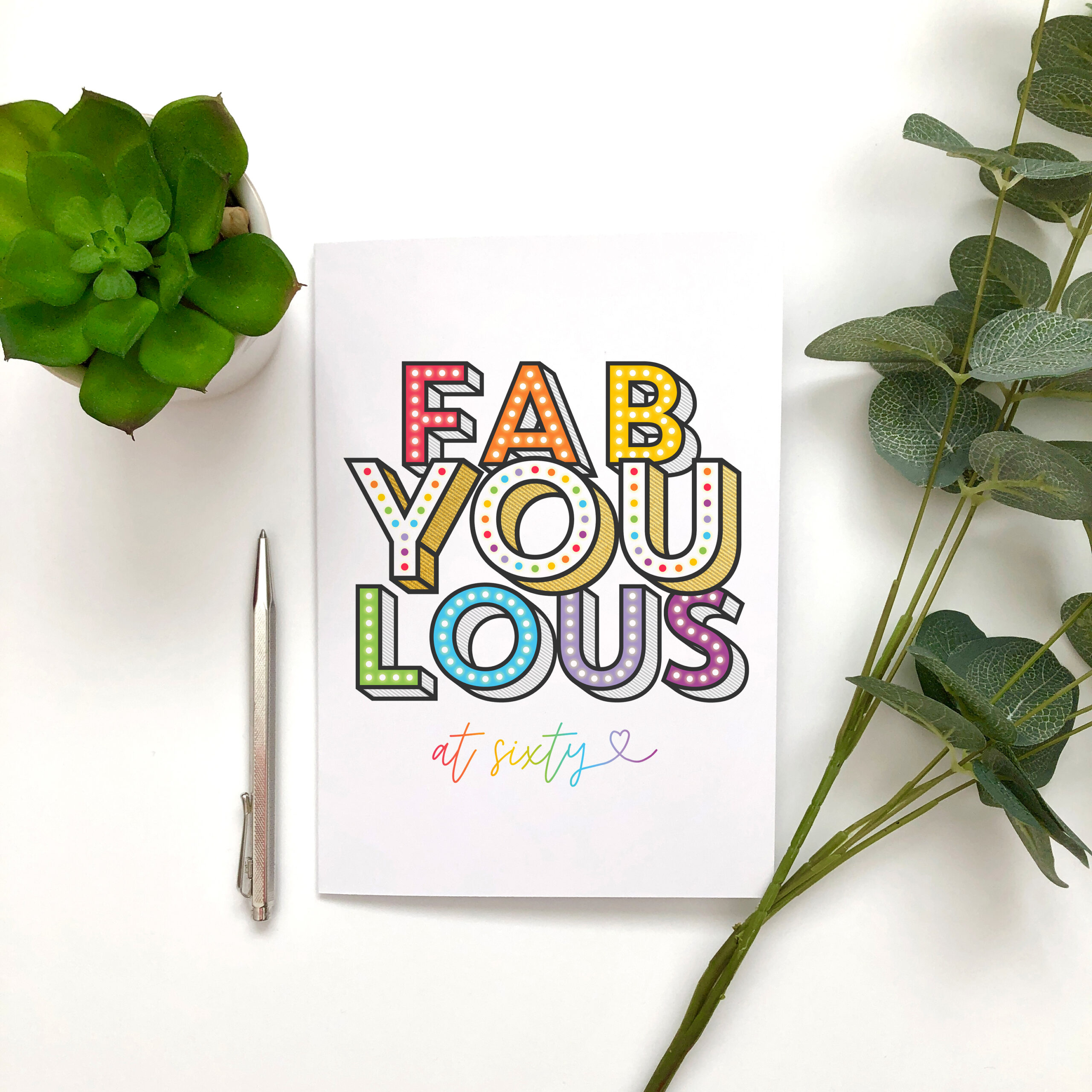 Bright and colourful typography based birthday card design with the positive message Fabulous at Sixty