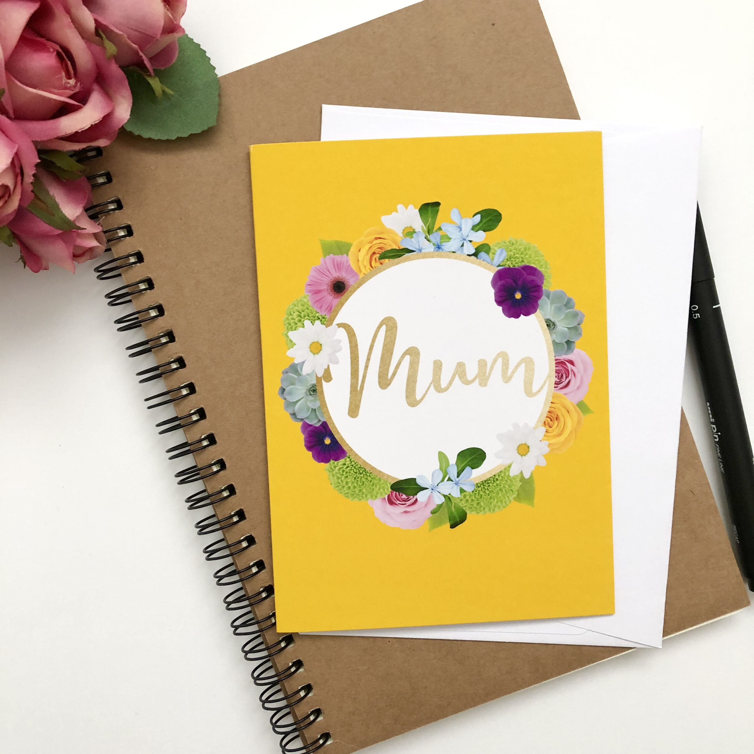 Floral Greetings cards for Mum featuring colourful flowers around gold lettering on a bright sanguine yellow background