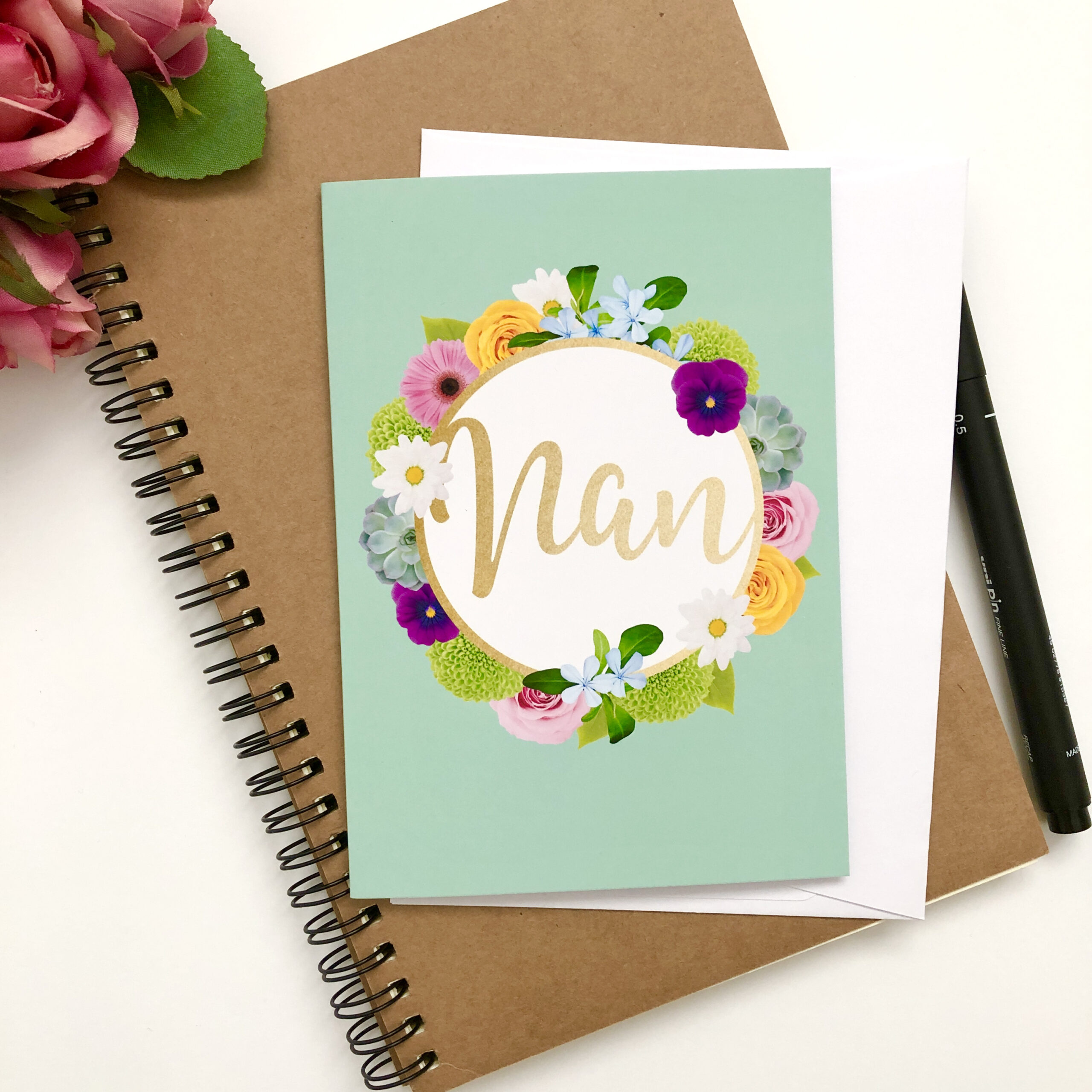 Greetings card for Nan with colourful floral wreath and a lovely green background
