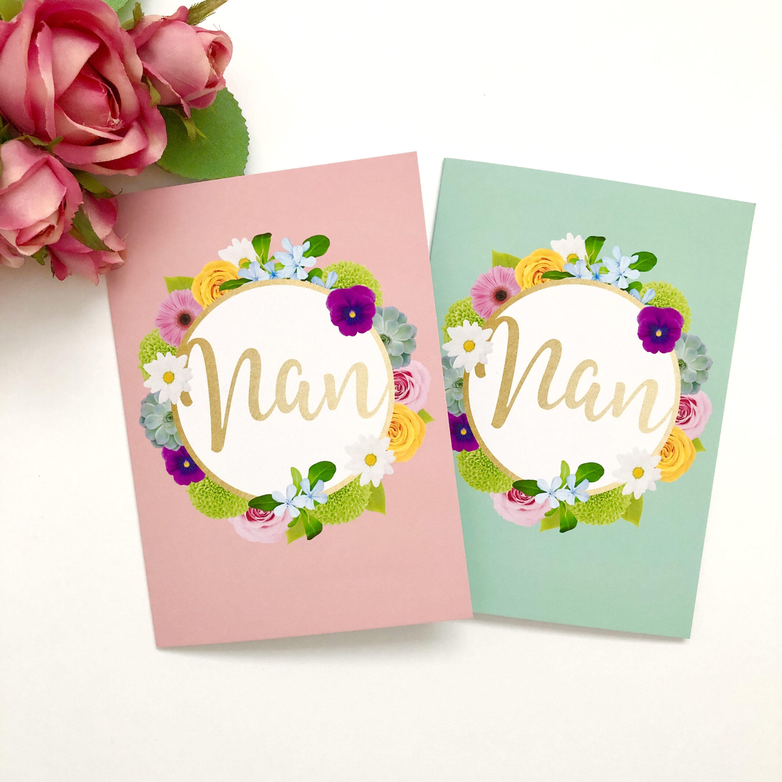 Two greetings cards for nan, both featuring colourful flowers, faux gold lettering with one on a pink background and the other on a green background