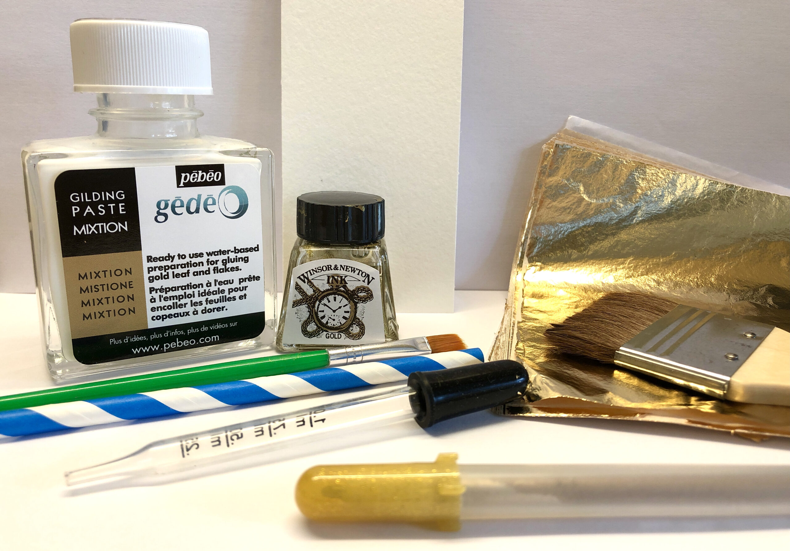 Materials and equipments required to create your own gold abstract bookmark
