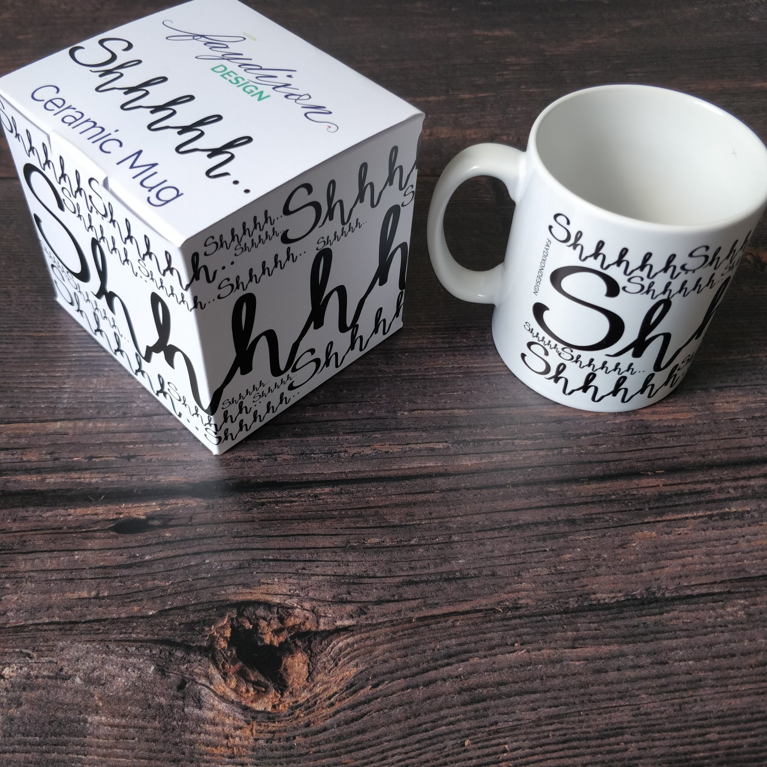 Gift for book lover - white ceramic mug featuring the word shhhhh wrapped around it by Fay Dixon Design